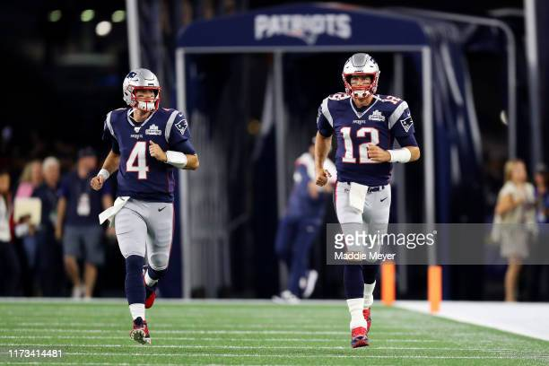 Tom Brady of the New England Patriots and Jarrett Stidham enter the field before the game between the New England Patriots and the Pittsburgh...