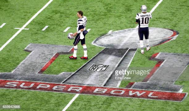 Tom Brady of the New England Patriots and Jimmy Garoppolo take the field prior to Super Bowl 51 against the Atlanta Falcons at NRG Stadium on...