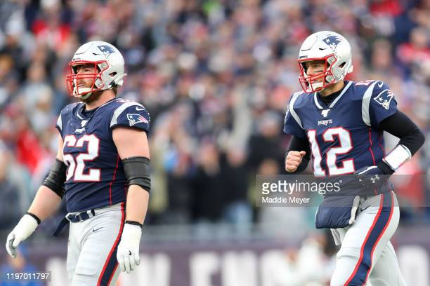 Tom Brady of the New England Patriots and Joe Thuney during the game against the Miami Dolphins at Gillette Stadium on December 29 2019 in Foxborough...