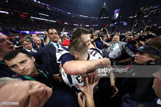 Tom Brady of the New England Patriots and Julian Edelman celebrate their teams 13-3 win over the Los Angeles Rams during Super Bowl LIII at...