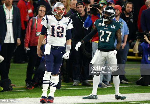 Tom Brady of the New England Patriots and Malcolm Jenkins of the Philadelphia Eagles react during the second quarter in Super Bowl LII at US Bank...