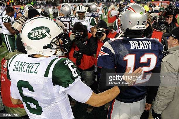 Tom Brady of the New England Patriots and Mark Sanchez of the New York Jets walk off the field after the Jets defeated the Patriots 28 to 21 their...