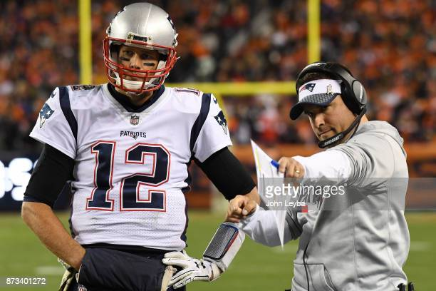 Tom Brady of the New England Patriots and offensive coordinator Josh McDaniels talk in the second quarter against the Denver Broncos The Denver...