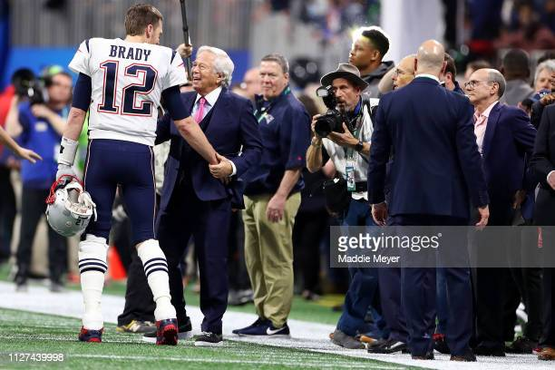Tom Brady of the New England Patriots and Patriots owner Robert Kraft talk before Super Bowl LIII at MercedesBenz Stadium on February 03 2019 in...