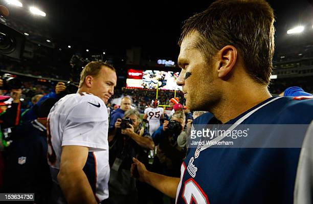Tom Brady of the New England Patriots and Peyton Manning of the Denver Broncos greet each other at midfield following the game on October 7 2012 at...