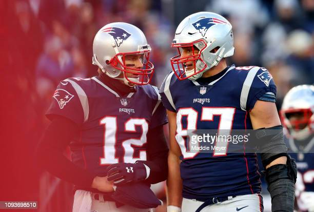 Tom Brady of the New England Patriots and Rob Gronkowski react during the third quarter in the AFC Divisional Playoff Game against the Los Angeles...