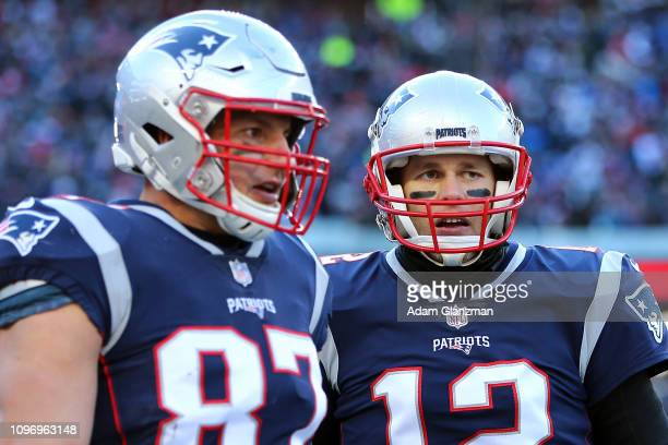 Tom Brady of the New England Patriots and Rob Gronkowski react during the second quarter in the AFC Divisional Playoff Game against the Los Angeles...