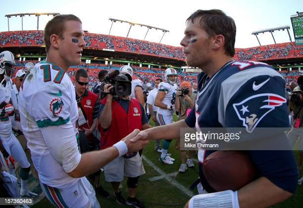 Tom Brady of the New England Patriots and Ryan Tannehill of the Miami Dolphins shakes hands after a game at Sun Life Stadium on December 2 2012 in...