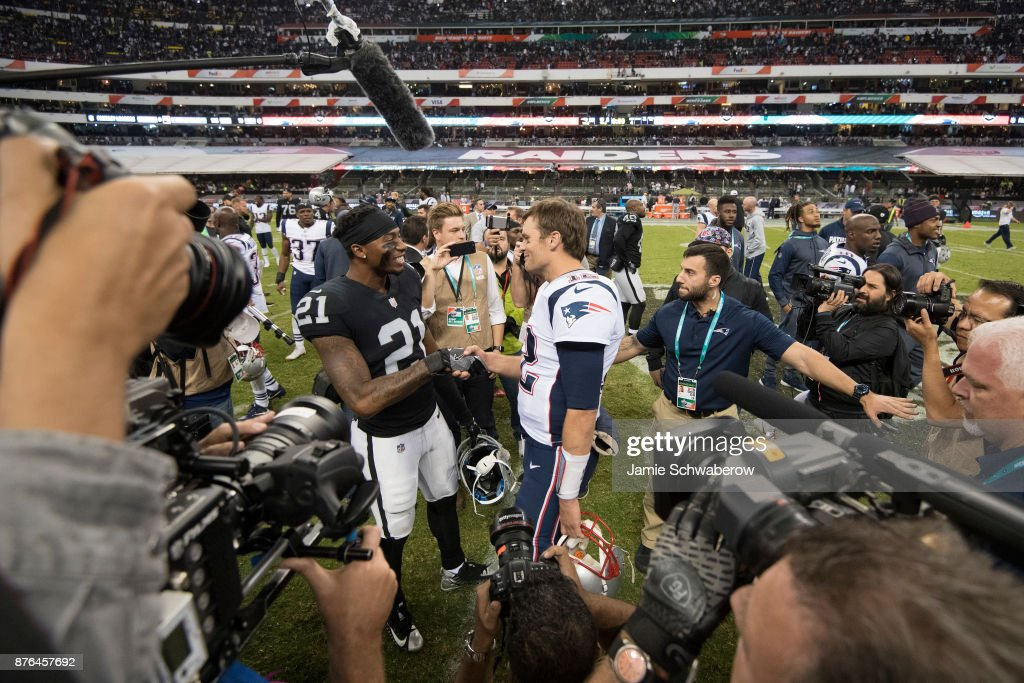 Tom Brady #12 of the New England Patriots and Sean Smith #21 shake hands after the game at Estadio Azteca on November 19, 2017 in Mexico City, Mexico.