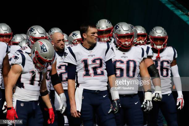 Tom Brady of the New England Patriots and teammates prepare to take the field for their game against the Miami Dolphins at Hard Rock Stadium on...
