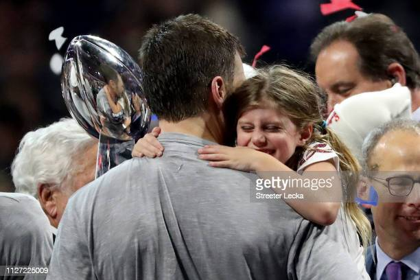 Tom Brady of the New England Patriots and Vivian Lake Brady celebrate their 133 win over Los Angeles Rams during Super Bowl LIII at MercedesBenz...