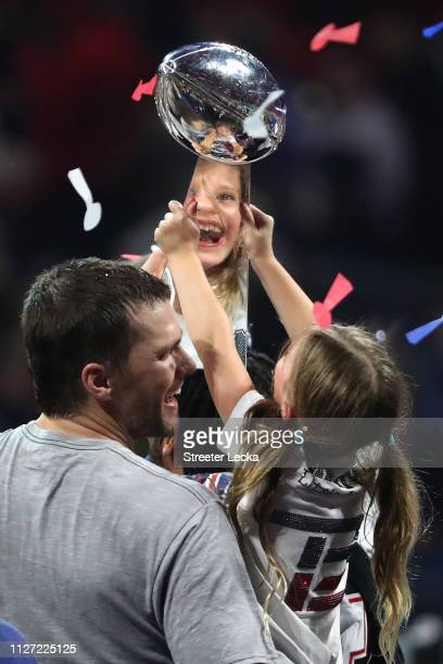 Tom Brady of the New England Patriots and Vivian Lake Brady celebrate with the Vince Lombardi trophy after the teams 13-3 win over Los Angeles Rams...