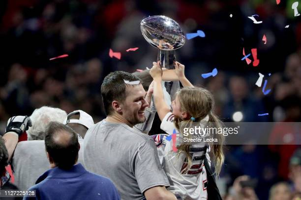 Tom Brady of the New England Patriots and Vivian Lake Brady celebrate with the Vince Lombardi trophy after the teams 133 win over Los Angeles Rams...