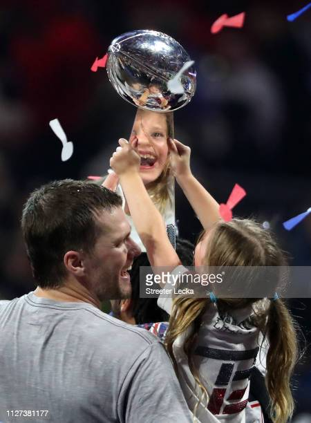 Tom Brady of the New England Patriots and Vivian Lake Brady celebrate with the Vince Lombardi trophy after the teams 13-3 win over the Los Angeles...