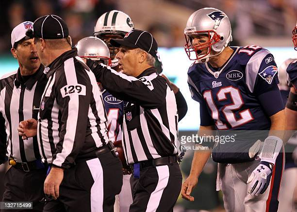Tom Brady of the New England Patriots argues with the umpire Bill Schuster side judge Tom Hill after a call during the game against the New York Jets...