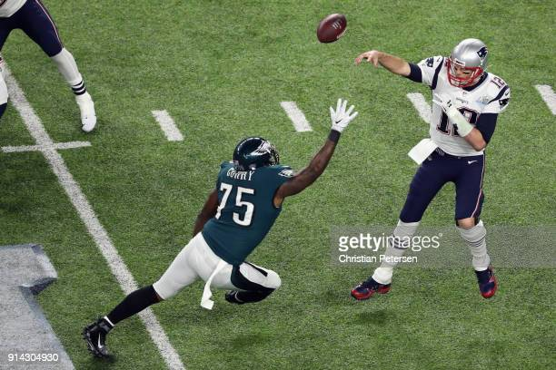 Tom Brady of the New England Patriots attempts a pass against Vinny Curry of the Philadelphia Eagles in the first quarter of Super Bowl LII at US...