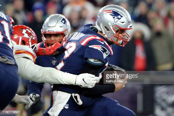 Tom Brady of the New England Patriots attempts to escape pressure during the first half against the Kansas City Chiefs in the game at Gillette...