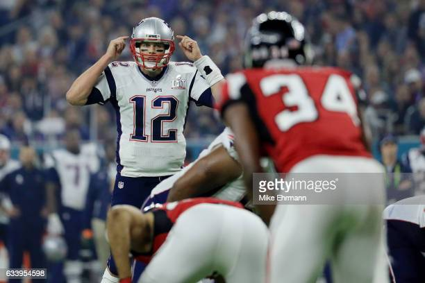 Tom Brady of the New England Patriots calls a play against the Atlanta Falcons in the fourth quarter during Super Bowl 51 at NRG Stadium on February...