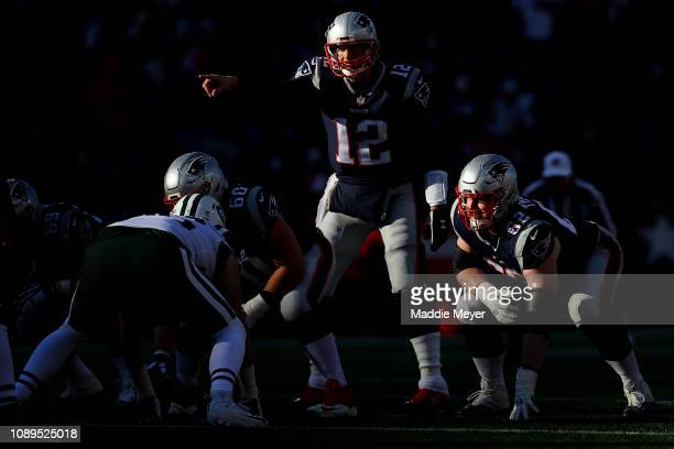 Tom Brady of the New England Patriots calls a play during the game against the New York Jets at Gillette Stadium on December 30 2018 in Foxborough...