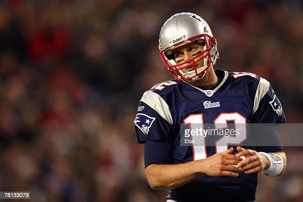 Tom Brady of the New England Patriots calls a timeout at the line against the Philadelphia Eagles at Gillette Stadium on November 25 2007 in Foxboro...