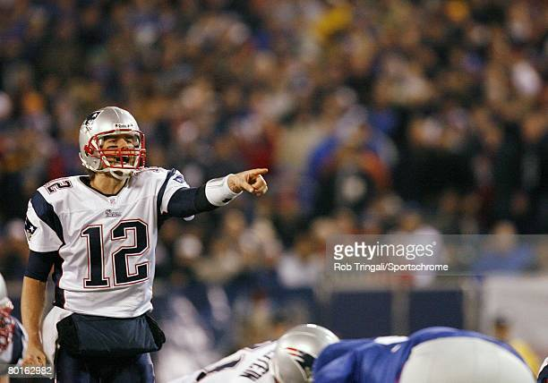 Tom Brady of the New England Patriots calls signals against the New York Giants during their game on December 29 2007 at Giants Stadium in East...