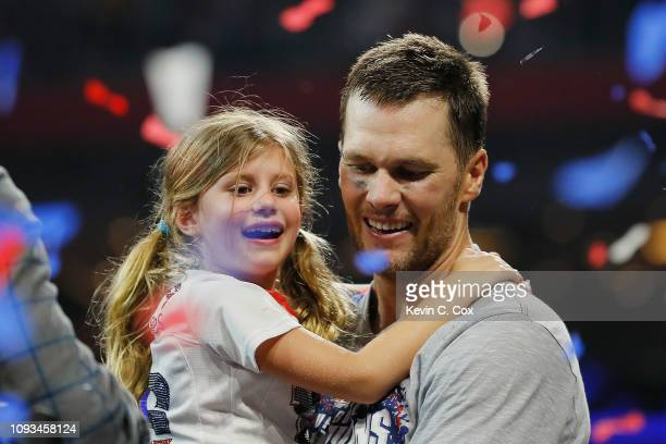 Tom Brady of the New England Patriots carries his daughter Vivian Lake Brady at the end of the Super Bowl LIII at MercedesBenz Stadium on February 3...