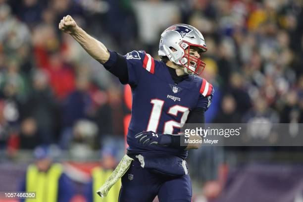 Tom Brady of the New England Patriots celebrates a second quarter touchdown by Cordarrelle Patterson against the Green Bay Packers at Gillette...