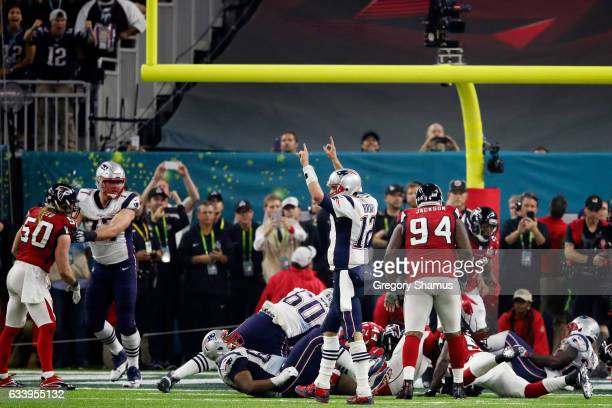 Tom Brady of the New England Patriots celebrates after a score against the Atlanta Falcons in the fourth quarter during Super Bowl 51 at NRG Stadium...