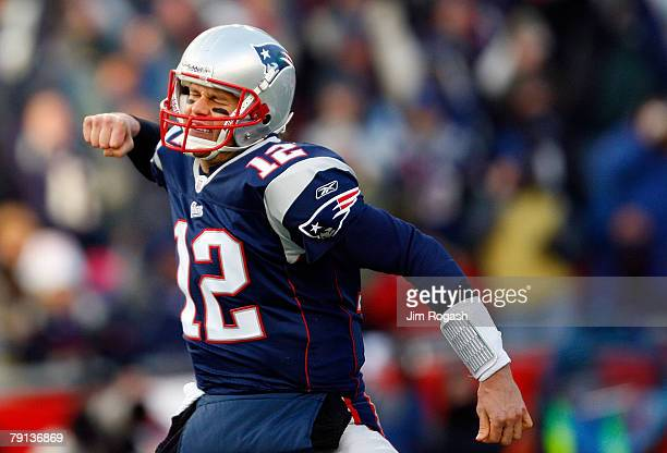Tom Brady of the New England Patriots celebrates after a touchdown in the second quarter against the San Diego Chargers during the AFC Championship...