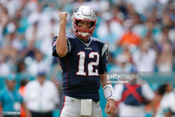 Tom Brady of the New England Patriots celebrates after a touchdown against the Miami Dolphins at Hard Rock Stadium on September 15, 2019 in Miami,...
