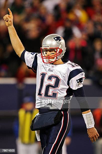 Tom Brady of the New England Patriots celebrates after converting the two point conversion against the New York Giants on December 29 2007 at Giants...