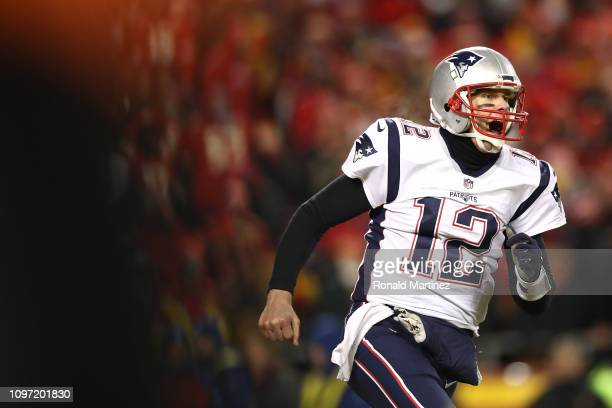 Tom Brady of the New England Patriots celebrates after defeating the Kansas City Chiefs in overtime during the AFC Championship Game at Arrowhead...
