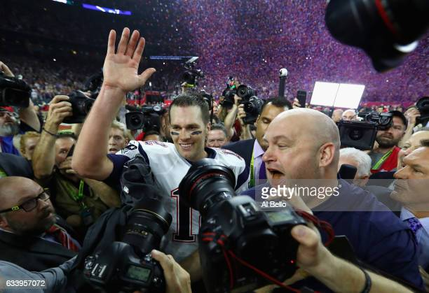 Tom Brady of the New England Patriots celebrates after defeating the Atlanta Falcons 3428 in overtime of Super Bowl 51 at NRG Stadium on February 5...