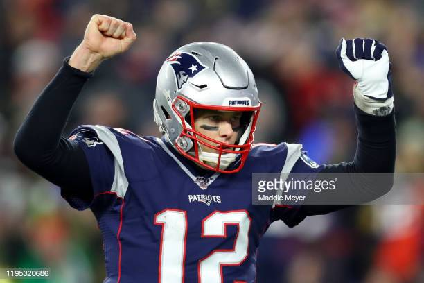 Tom Brady of the New England Patriots celebrates after Rex Burkhead scored a touchdown against the Buffalo Bills in the fourth quarter at Gillette...