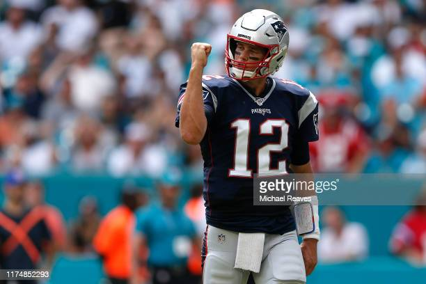Tom Brady of the New England Patriots celebrates after Sony Michel scored a one yard touchdown against the Miami Dolphins during the first quarter in...