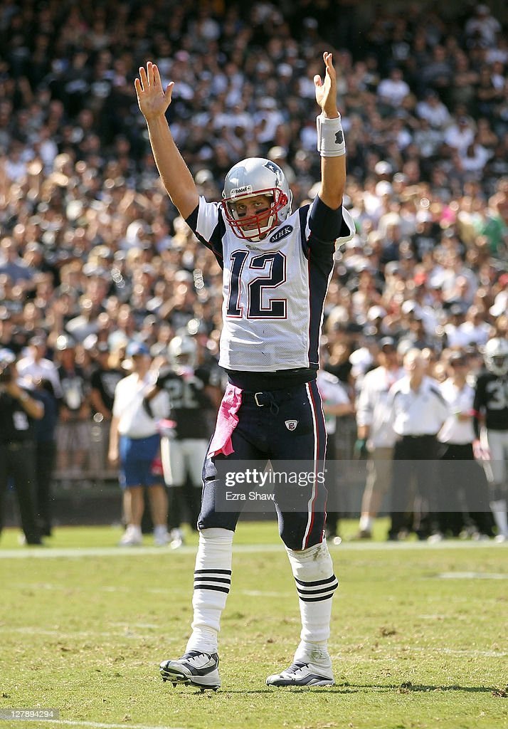 Tom Brady #12 of the New England Patriots celebrates after the Patriots scored a touchdown against the Oakland Raiders at O.co Coliseum on October 2, 2011 in Oakland, California.