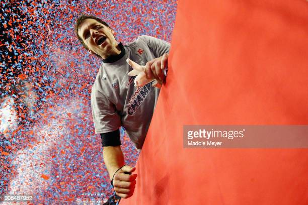 Tom Brady of the New England Patriots celebrates after winning the AFC Championship Game against the Jacksonville Jaguars at Gillette Stadium on...