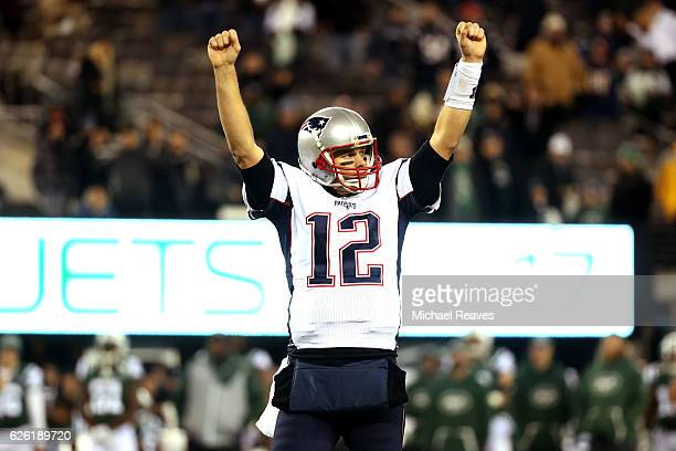 Tom Brady of the New England Patriots celebrates against the New York Jets during the fourth quarter in the game at MetLife Stadium on November 27...