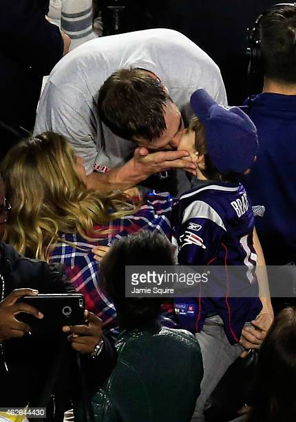 Tom Brady of the New England Patriots celebrates defeating the Seattle Seahawks with his wife Gisele Bundchen and son Benjamin during Super Bowl XLIX...