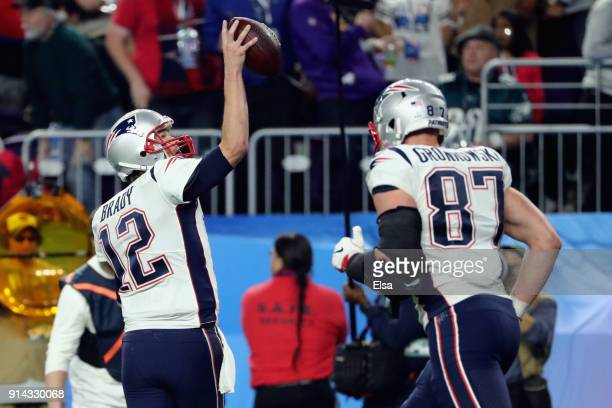Tom Brady of the New England Patriots celebrates making a 26yard touchdown pass to Chris Hogan of the New England Patriots in the third quarter of...