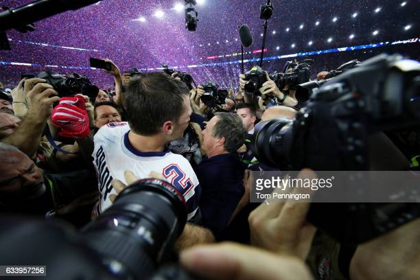 Tom Brady of the New England Patriots celebrates on the field after defeating the Atlanta Falcons 3428 in overtime to win Super Bowl 51 at NRG...
