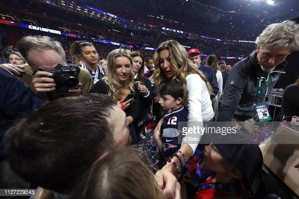 Tom Brady of the New England Patriots celebrates with Benjamin Rein Brady and Gisele Bündchen after his 133 win against Los Angeles Rams during Super...