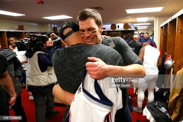 Tom Brady of the New England Patriots celebrates with Brian Hoyer in the locker room after defeating the Kansas City Chiefs in overtime during the...