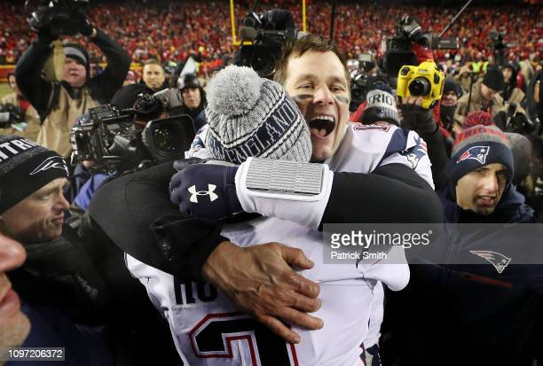 Tom Brady of the New England Patriots celebrates with Brian Hoyer after defeating the Kansas City Chiefs in overtime during the AFC Championship Game...