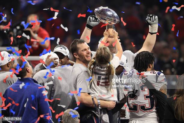 Tom Brady of the New England Patriots celebrates with daughter Vivian who raises the Vince Lombardi Trophy after Super Bowl LIII at MercedesBenz...