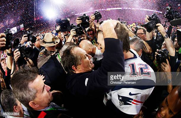 Tom Brady of the New England Patriots celebrates with head coach Bill Belichick after defeating the Seattle Seahawks 2824 during Super Bowl XLIX at...