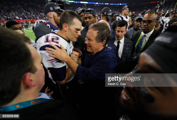 Tom Brady of the New England Patriots celebrates with head coach Bill Belichick after the Patriots defeat the Atlanta Falcons 3428 in overtime of...