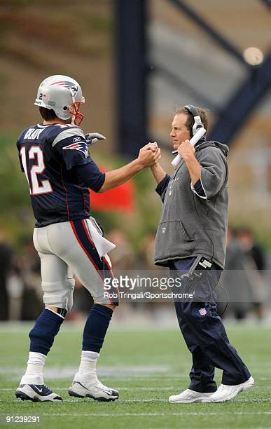 Tom Brady of the New England Patriots celebrates with Head Coach Bill Belichick after a touchdown against the Atlanta Falcons on September 27 2009 at...