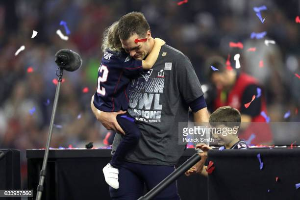 Tom Brady of the New England Patriots celebrates with his children after defeating the Atlanta Falcons during Super Bowl 51 at NRG Stadium on...