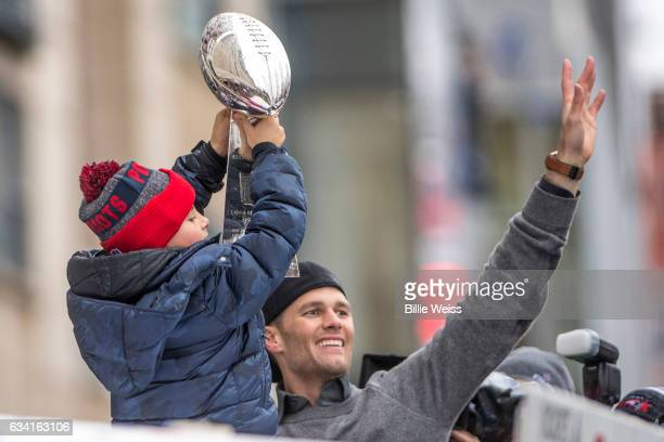 Tom Brady of the New England Patriots celebrates with his son Benjamin during the Super Bowl victory parade on February 7 2017 in Boston...